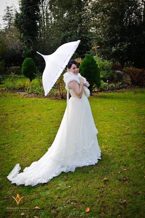 bride with white umbrella