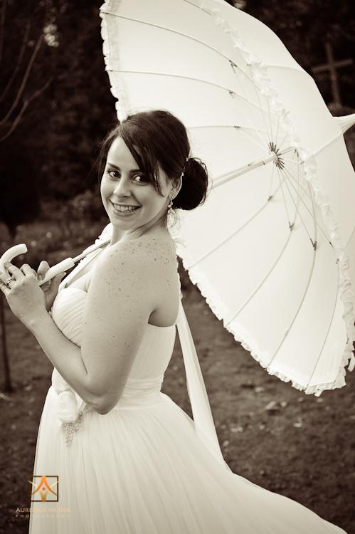 bride with white umbrella in black and white