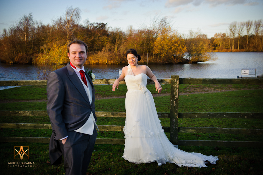 groom and the bride by the lake