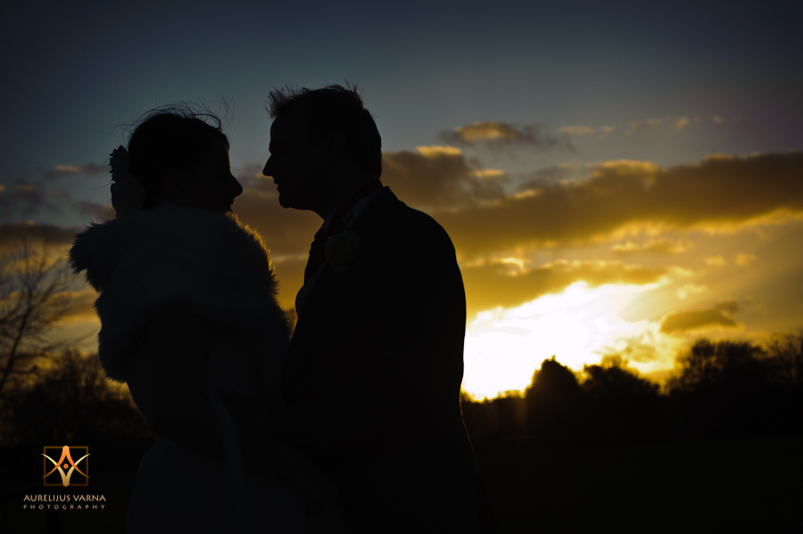 bride and groom and the sun set